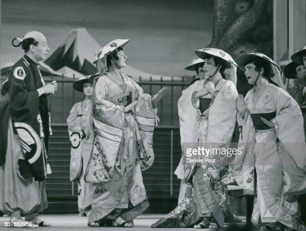 Ko Ko the Lord High Executioner in Gilbert and Sullivan's 'The Mikado' is kept mighty busy with his official duties and his three pretty wards Yum...