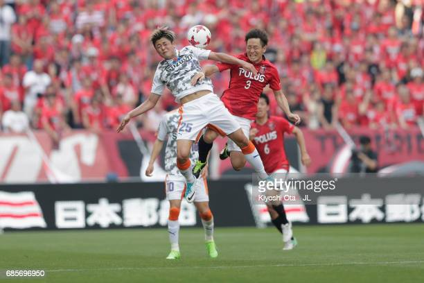 Ko Matsubara of Shimizu SPulse and Tomoya Ugajin of Urawa Red Diamonds compete for the ball during the JLeague J1 match between Urawa Red Diamonds...