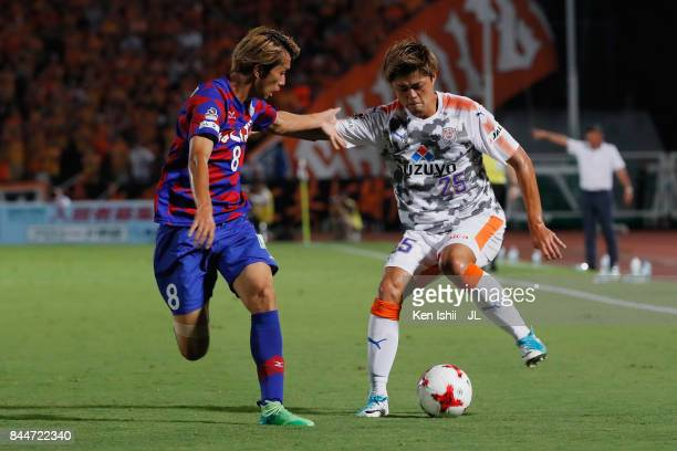 Ko Matsubara of Shimizu SPulse takes on Ryohei Arai of Ventforet Kofu compete for the ball during the JLeague J1 match between Ventforet Kofu and...