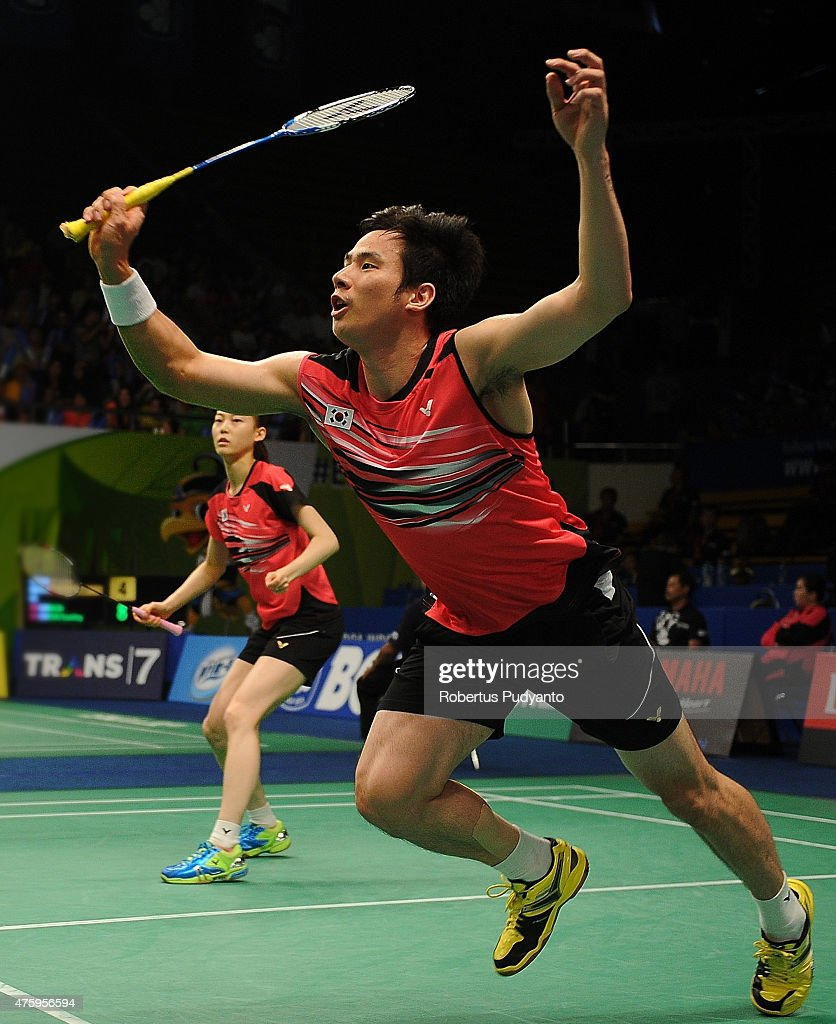Ko Sung Hyun and Kim Ha Na of Korea return a shot against Joachim Fischer Nielsen and Christinna Pedersen of Denmark during the 2015 BCA Indonesia Open Quarterfinals match at Istora Senayan on June 5, 2015 in Jakarta, Indonesia.