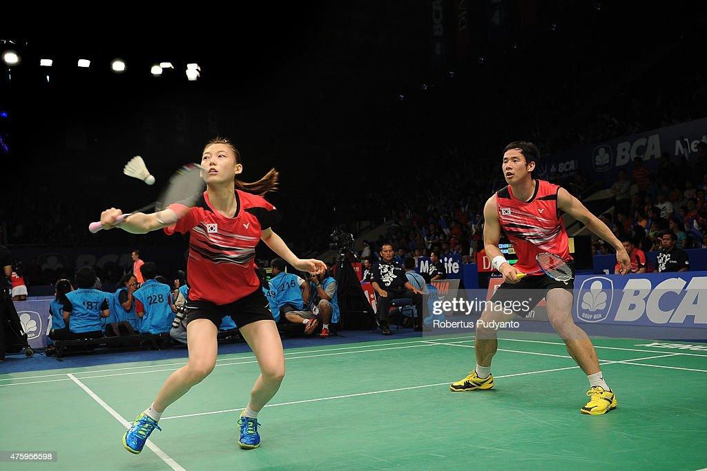 Ko Sung Hyun and Kim Ha Na of Korea return a shot against Joachim Fischer Nielsen and Christinna Pedersen of Denmark during the 2015 BCA Indonesia Open Quarterfinals match at Istora Senayan on June 5, 2015 in Jakarta, Indonesia.