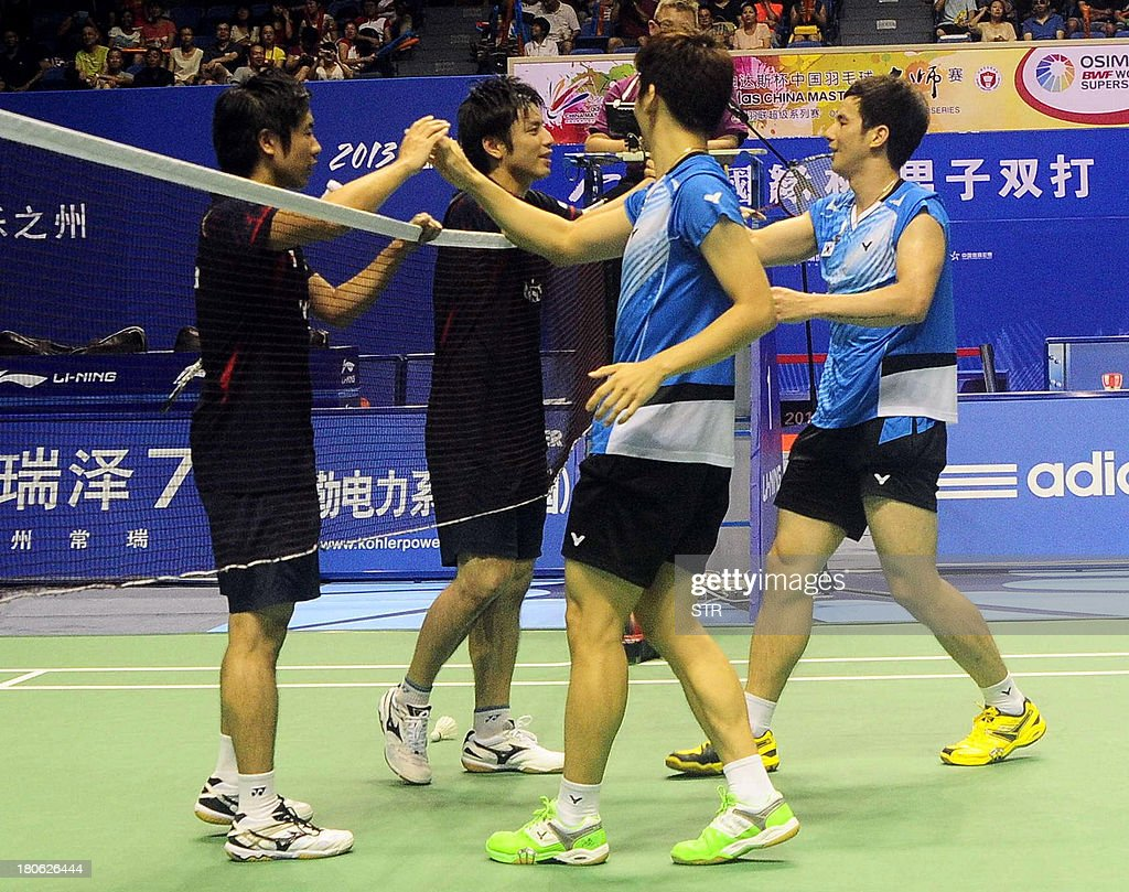 Ko Sung Hyun (R) and Lee Yong Dae of South Korea shake hands with Hiroyuki Endo (L) and Kenichi Hayakawa of Japan after winning the men's doubles final match of the 2013 China Masters in Changzhou, east China's Jiangsu province on September 15, 2013. Ko and Lee won 25-23, 21-19. CHINA