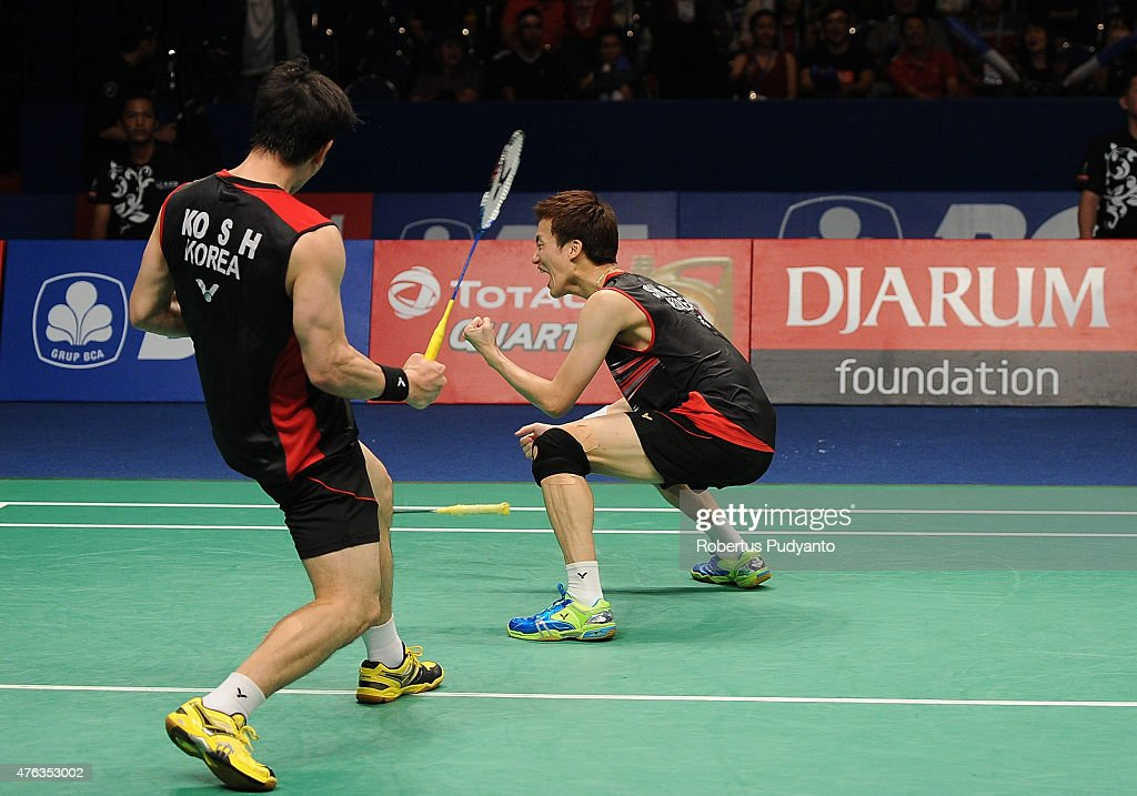Ko Sung Hyun and Shin Baek Choel of Korea react after winning Men's Doubles Final against Fu Haifeng and <a gi-track='captionPersonalityLinkClicked' href=/galleries/search?phrase=Zhang+Nan+-+Badminton+Player&family=editorial&specificpeople=9612243 ng-click='$event.stopPropagation()'>Zhang Nan</a> of China during the 2015 BCA Indonesia Open at Istora Senayan on June 7, 2015 in Jakarta, Indonesia.