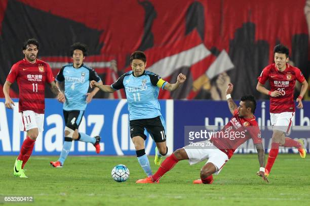 Kobayashi Yu of Kawasaki Frontale in action against Paulinho of Guangzhou Evergrande during 2017 AFC Asian Champions League group match between...