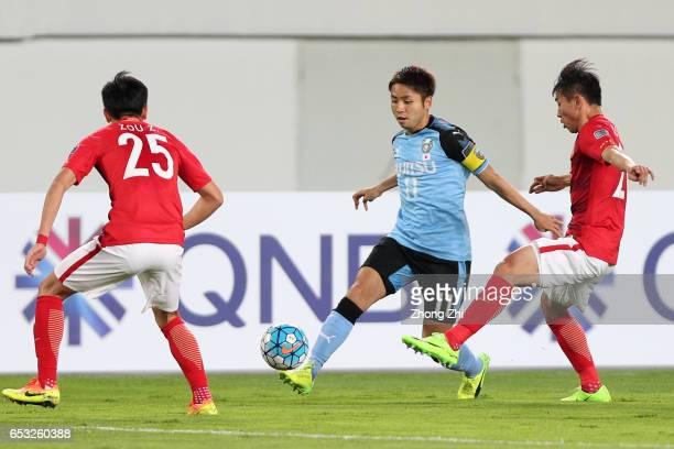 Kobayashi Yu of Kawasaki Frontale in action against Zou Zheng and Yu Hanchao of Guangzhou Evergrande during 2017 AFC Asian Champions League group...