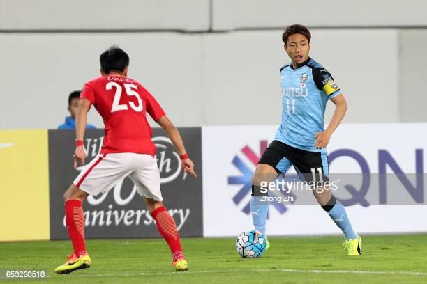 Kobayashi Yu of Kawasaki Frontale in action against Zou Zheng of Guangzhou Evergrande during 2017 AFC Asian Champions League group match between...