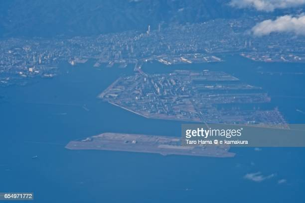 Kobe airport and Port Island in Kobe city, daytime aerial view from airplane