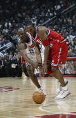 Kobe Bryant of the Western Conference All Stars battles for possession with Michael Jordan of the Eastern Conference All Stars during the 2003 NBA...