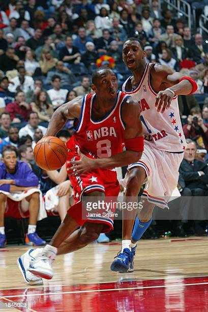 Kobe Bryant of the Western Conference AllStars drives past Tracy McGrady of the Eastern Conference AllStars in overtime during the 2003 NBA AllStar...