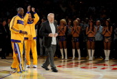 Kobe Bryant and Derek Fisher of the Los Angeles Lakers greet Lakers owner Jerry Buss during a ceremony prior to their opening night game against the...