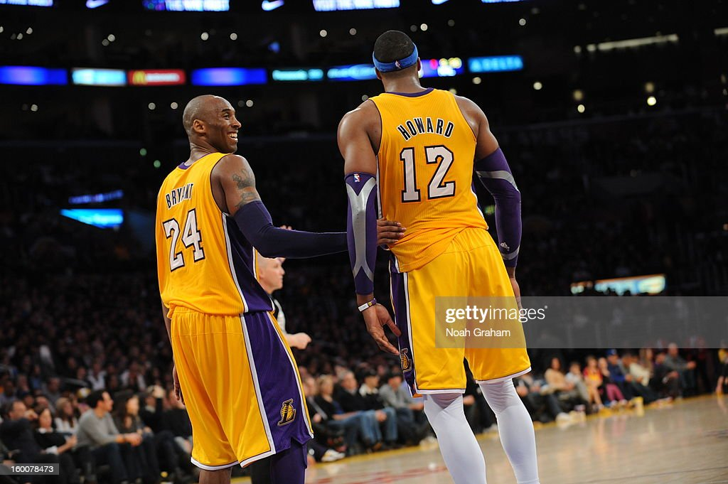 Kobe Bryant #24 and Dwight Howard #12 of the Los Angeles Lakers celebrate during their game against the Utah Jazz at Staples Center on January 25, 2013 in Los Angeles, California.