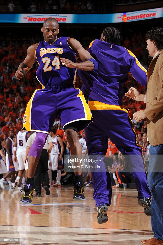 <a gi-track='captionPersonalityLinkClicked' href=/galleries/search?phrase=Kobe+Bryant&family=editorial&specificpeople=201466 ng-click='$event.stopPropagation()'>Kobe Bryant</a> #24 and <a gi-track='captionPersonalityLinkClicked' href=/galleries/search?phrase=Josh+Powell&family=editorial&specificpeople=546627 ng-click='$event.stopPropagation()'>Josh Powell</a> #21 of the Los Angeles Lakers celebrate during a timeout against the Phoenix Suns in Game Six of the Western Conference Finals during the 2010 NBA Playoffs at US Airways Center on May 29, 2010 in Phoenix, Arizona.