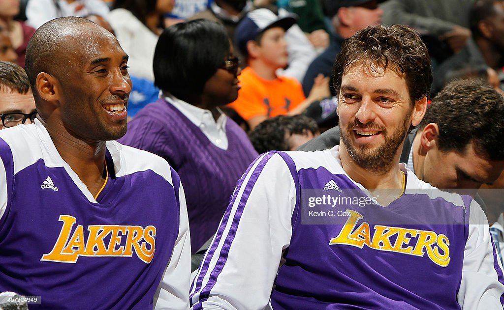 Kobe Bryant #24 and Pau Gasol #16 of the Los Angeles Lakers enjoy a laugh during the first half against the Atlanta Hawks at Philips Arena on December 16, 2013 in Atlanta, Georgia.