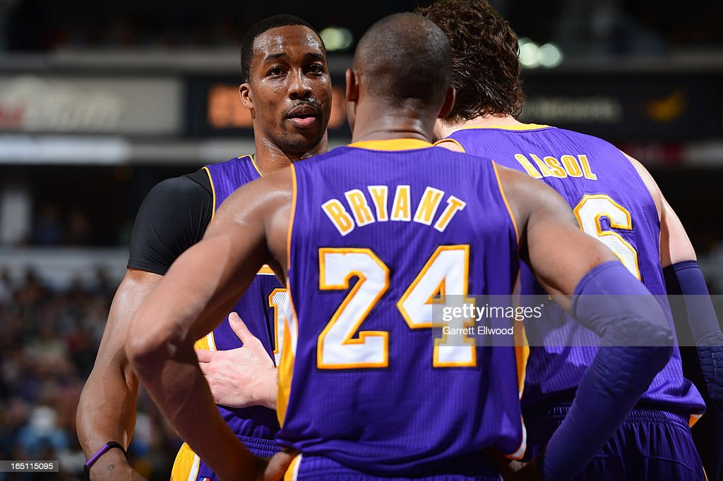 Kobe Bryant #24 and Paul Gasol #16 talk with Dwight Howard #12 of the Los Angeles Lakers during a break in action against the Sacramento Kings on March 30, 2013 at Sleep Train Arena in Sacramento, California.