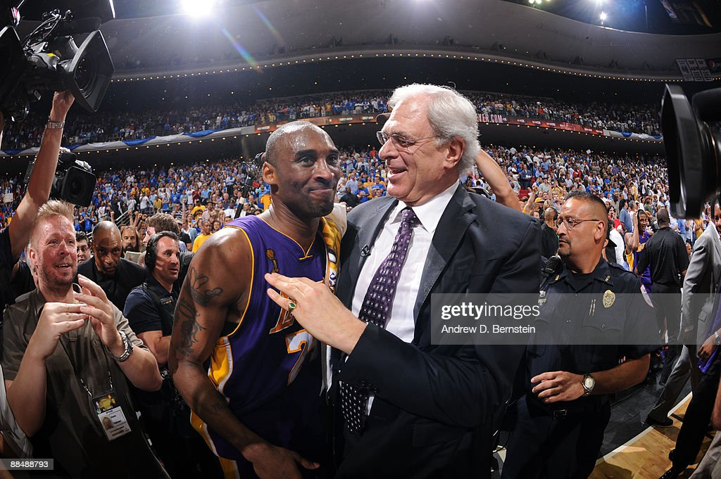 Kobe Bryant #24 and Phil Jackson, head coach of the Los Angeles Lakers celebrate after defeating the Orlando Magic in Game Five of the 2009 NBA Finals at Amway Arena on June 14, 2009 in Orlando, Florida. The Los Angeles Lakers won 99-86 against the Orlando Magic.