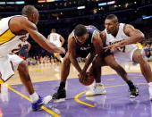 Kobe Bryant and Ron Artest of the Los Angeles Lakers pressure Joe Johnson of the Atlanta Hawks during the NBA basketball game at Staples Center on...