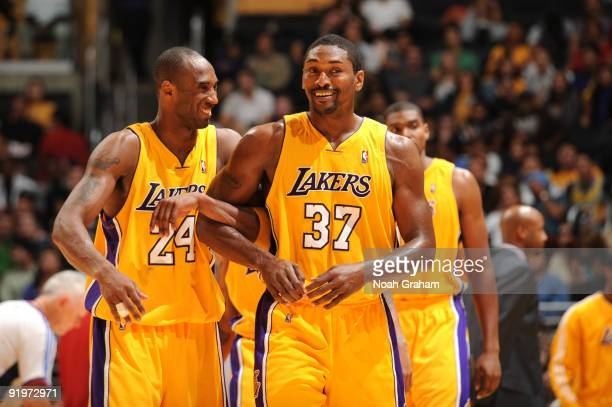Kobe Bryant and Ron Artest of the Los Angeles Lakers share a laugh during their game against the Charlotte Bobcats at Staples Center on October 17...