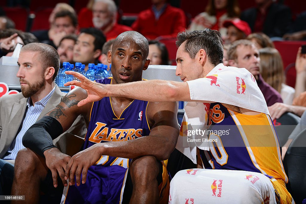 Kobe Bryant #24 and Steve Nash #10 of the Los Angeles Lakers talk on the bench during the game against the Houston Rockets on January 8, 2013 at the Toyota Center in Houston, Texas.