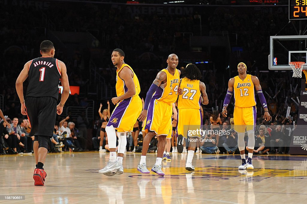 <a gi-track='captionPersonalityLinkClicked' href=/galleries/search?phrase=Kobe+Bryant&family=editorial&specificpeople=201466 ng-click='$event.stopPropagation()'>Kobe Bryant</a> #24 and the Los Angeles Lakers look on during the game against the Portland Trail Blazers at Staples Center on December 28, 2012 in Los Angeles, California.