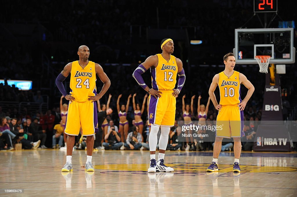 Kobe Bryant #24, Dwight Howard #12, and Steve Nash #10 of the Los Angeles Lakers look on against the Miami Heat at Staples Center on January 15, 2013 in Los Angeles, California.