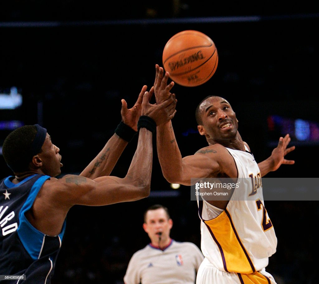 Kobe Bryant fights for the ball with Maverick Josh Howard in the