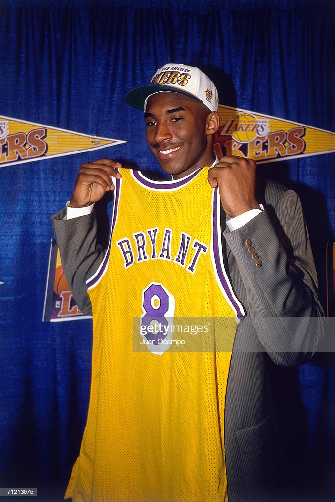 <a gi-track='captionPersonalityLinkClicked' href=/galleries/search?phrase=Kobe+Bryant&family=editorial&specificpeople=201466 ng-click='$event.stopPropagation()'>Kobe Bryant</a> holds a #8 Los Angeles Lakers jersey after being the 13th overall pick in the 1996 NBA Draft by the Charlotte Hornets who then traded his draft rights to the Los Angeles Lakers on July 11, 1996 in Inglewood, California.