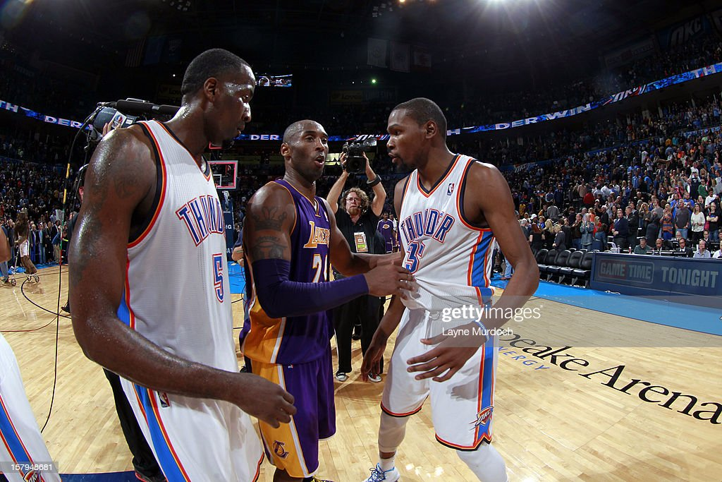 Kobe Bryant #24, Kevin Durant #35 and Kendrick Perkins #5 talk after the game on December 7, 2012 at the Chesapeake Energy Arena in Oklahoma City, Oklahoma.