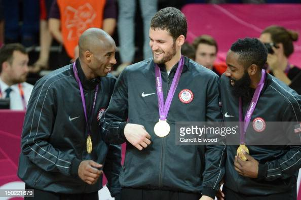 Kobe Bryant Kevin Love and James Harden of the US Men's Senior National Team celebrates on the podium with the Gold Medal after their Men's Gold...