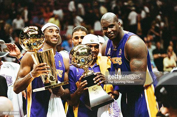 Kobe Bryant Lindsey Hunter and Shaquille O'Neal of the Los Angeles Lakers celebrate following Game Four of the NBA Finals against the New Jersey Nets...