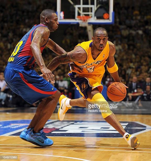 Kobe Bryant of Los Angeles Lakers competes with Pete Mickeal of Regal FC Barcelona during the NBA Europe Live game between Regal FC Barcelona vs LA...
