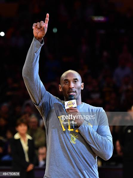 Kobe Bryant of the Los Angeles Lakers addresses the fans before the opening season game against the Minnesota Timberwolves at Staples Center on...