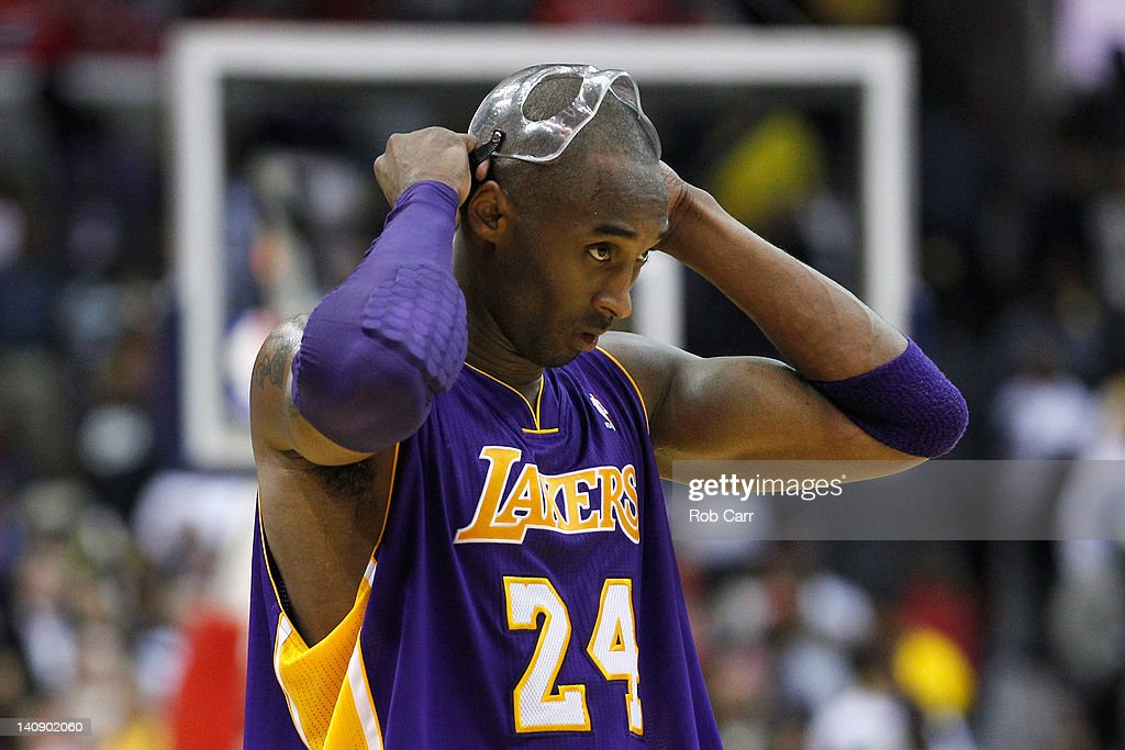 <a gi-track='captionPersonalityLinkClicked' href=/galleries/search?phrase=Kobe+Bryant&family=editorial&specificpeople=201466 ng-click='$event.stopPropagation()'>Kobe Bryant</a> #24 of the Los Angeles Lakers adjusts his mask during the closing moments of the Lakers 106-101 loss to the Washington Wizards at the Verizon Center on March 7, 2012 in Washington, DC.