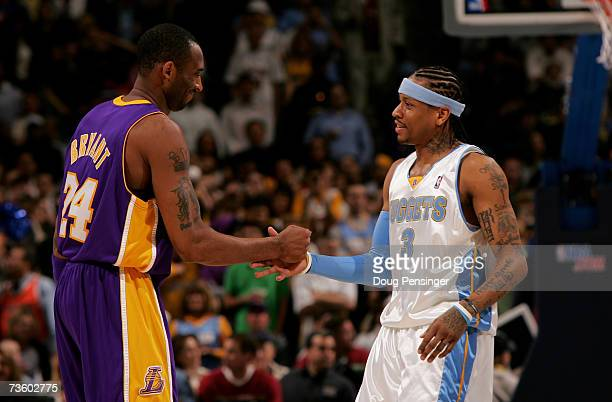 Kobe Bryant of the Los Angeles Lakers and Allen Iverson of the Denver Nuggets greet each other before the tip off during NBA action at the Pepsi...