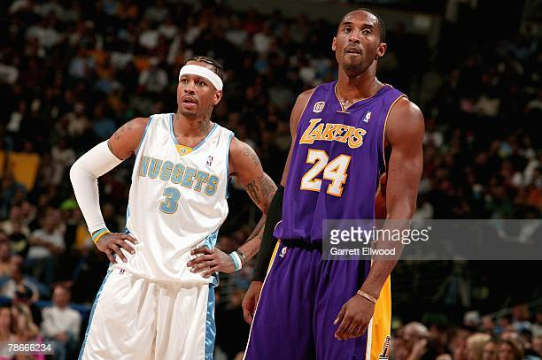 Kobe Bryant of the Los Angeles Lakers and Allen Iverson of the Denver Nuggets stand together on the court during the game on December 5 2007 at the...