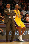 Kobe Bryant of the Los Angeles Lakers and Byron Scott head coach of the Los Angeles Lakers look on during a game against the Milwaukee Bucks at...