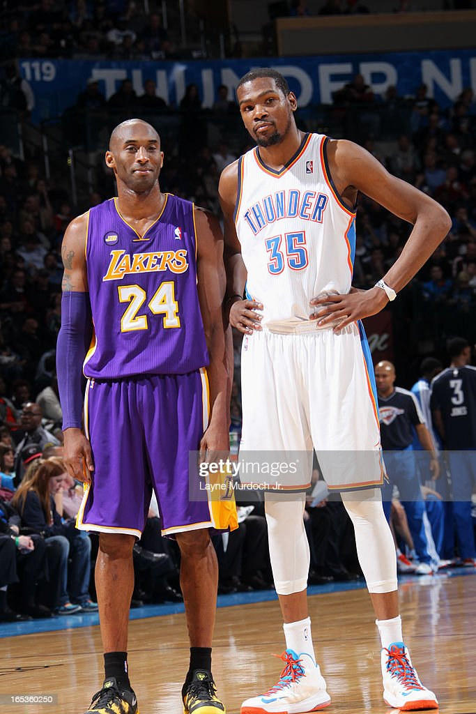 <a gi-track='captionPersonalityLinkClicked' href=/galleries/search?phrase=Kobe+Bryant&family=editorial&specificpeople=201466 ng-click='$event.stopPropagation()'>Kobe Bryant</a> #24 of the Los Angeles Lakers and <a gi-track='captionPersonalityLinkClicked' href=/galleries/search?phrase=Kevin+Durant&family=editorial&specificpeople=3847329 ng-click='$event.stopPropagation()'>Kevin Durant</a> #35 of the Oklahoma City Thunder stand on the court during the game on March 05, 2013 at the Chesapeake Energy Arena in Oklahoma City, Oklahoma.