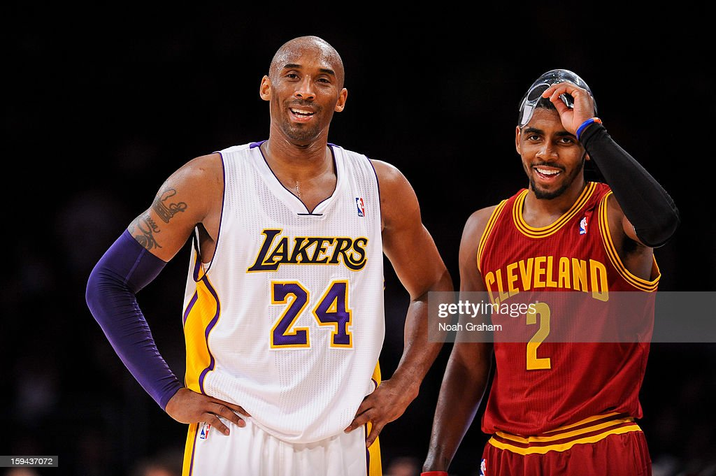Kobe Bryant #24 of the Los Angeles Lakers and Kyrie Irving #2 of the Cleveland Cavaliers share a laugh during their game at Staples Center on January 13, 2013 in Los Angeles, California.
