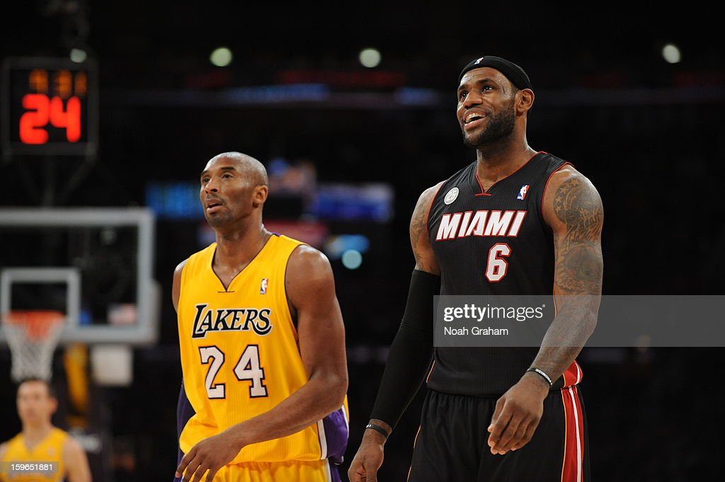 Kobe Bryant #24 of the Los Angeles Lakers and LeBron James #6 of the Miami Heat look on at Staples Center on January 15, 2013 in Los Angeles, California.