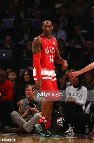 Kobe Bryant of the Los Angeles Lakers and the Western Conference reacts after a play in the first quarter against the Eastern Conference during the...