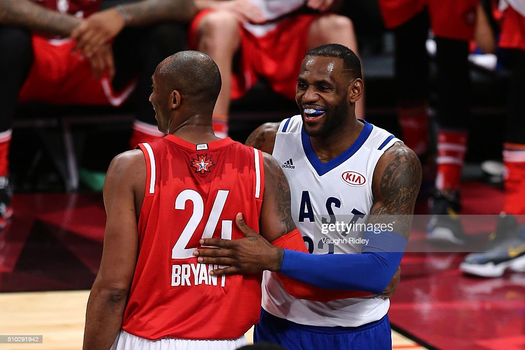 Kobe Bryant of the Los Angeles Lakers and the Western Conference and LeBron James of the Cleveland Cavaliers and the Eastern Conference laugh after a...