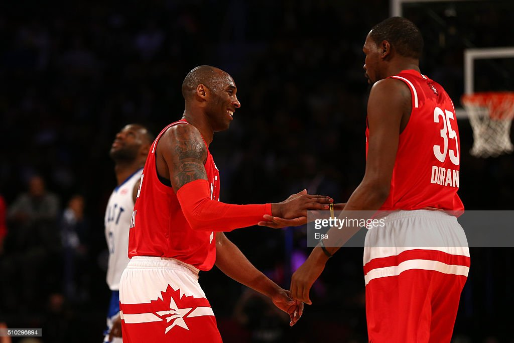 Kobe Bryant of the Los Angeles Lakers and the Western Conference and Kevin Durant of the Oklahoma City Thunder and the Western Conference celebrate...