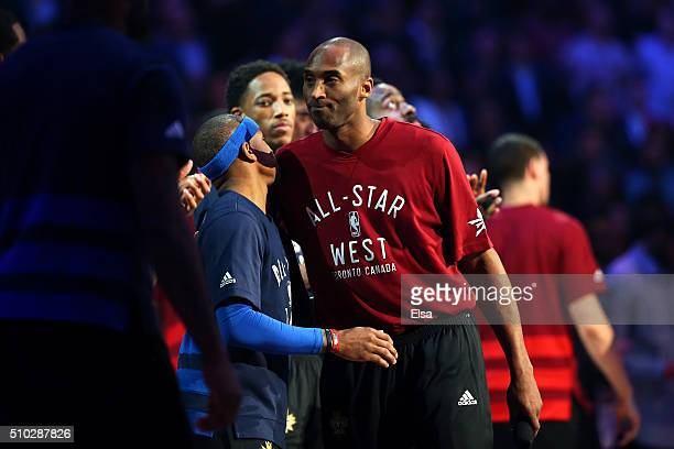 Kobe Bryant of the Los Angeles Lakers and the Western Conference hugs Isaiah Thomas of the Boston Celtics and the Eastern Conference during...