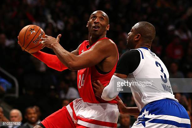Kobe Bryant of the Los Angeles Lakers and the Western Conference shoots in the second half against Dwyane Wade of the Miami Heat and the Eastern...