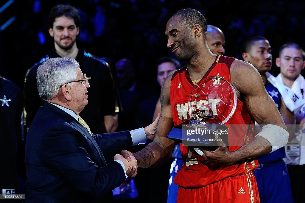 Kobe Bryant of the Los Angeles Lakers and the Western Conference shakes hands with NBA Commissioner David Stern after Bryant was named MVP for the...