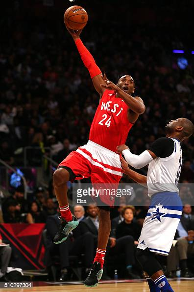 Kobe Bryant of the Los Angeles Lakers and the Western Conference shoots against Dwyane Wade of the Miami Heat and the Eastern Conference in the...