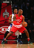 Kobe Bryant of the Los Angeles Lakers and the Western Conference handles the ball against Kyle Lowry of the Toronto Raptors and the Eastern...