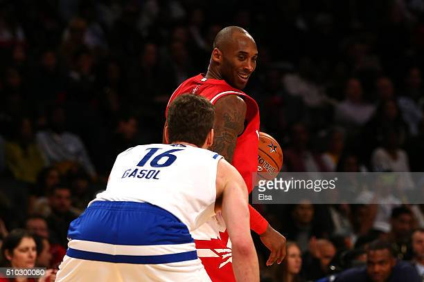 Kobe Bryant of the Los Angeles Lakers and the Western Conference handles the ball against Pau Gasol of the Chicago Bulls and the Eastern Conference...