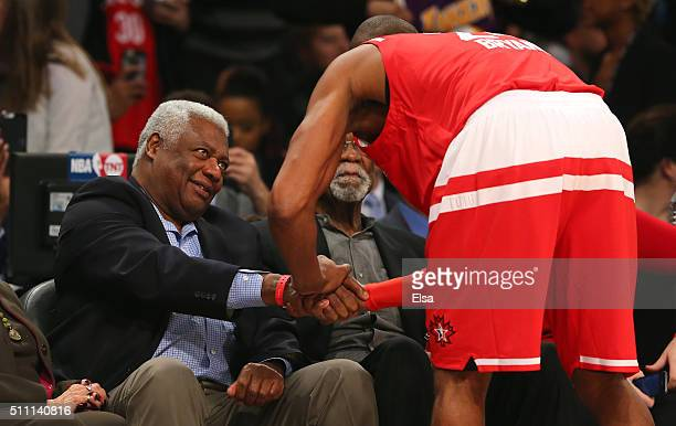 Kobe Bryant of the Los Angeles Lakers and the Western Conference speaks to NBA hall of famers Oscar Robertson and Bill Russell during the NBA AllStar...