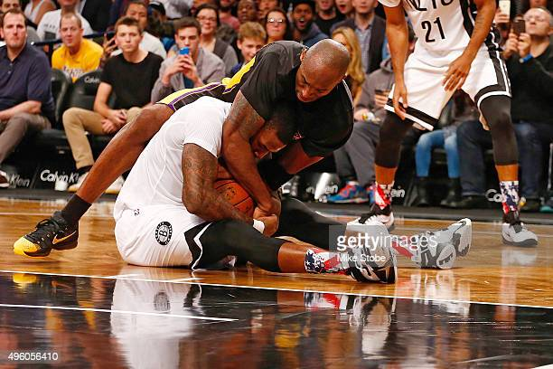 Kobe Bryant of the Los Angeles Lakers and Thomas Robinson of the Brooklyn Nets fight for the ball at the Barclays Center on November 6 2015 in the...
