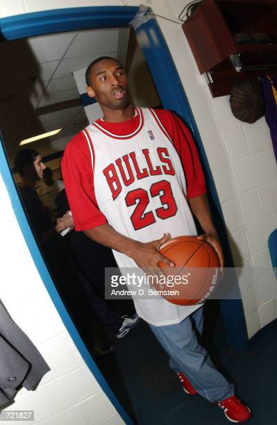 Kobe Bryant of the Los Angeles Lakers arrives wearing a Michael Jordan jersey before game four of the 2002 NBA Finals against the New Jersey Nets at...